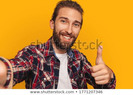 Hipster in shirt showing unusual gesture Stock photo © deandrobot