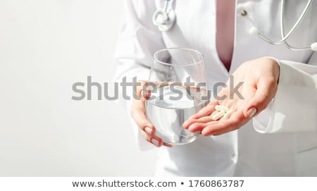 pharmacist giving pills and glass of water stock photo © rastudio