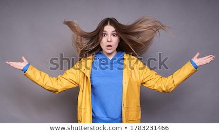 Portrait of blond model posing with hair fluttering in the wind Stock photo © julenochek