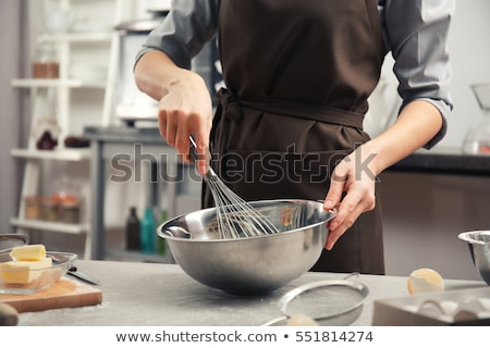 Woman beating eggs with a whisk in a bowl Stock photo © wavebreak_media