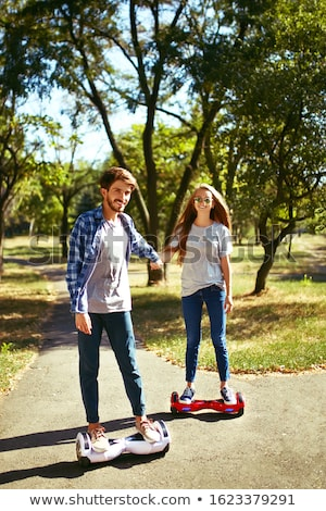 Young couple riding hoverboard Stock photo © vlad_star
