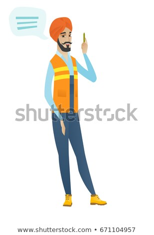 Stock photo: Young hindu builder with speech bubble.