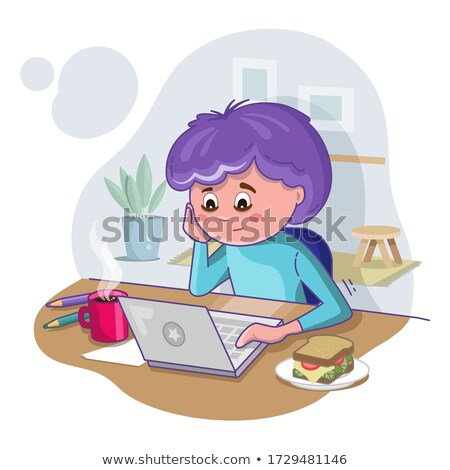 Bored young man seated at desk studying Stock photo © IS2