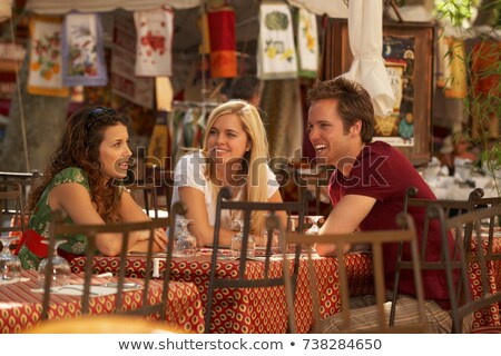 Friends talking in french market cafe Stock photo © IS2