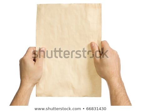 Man holding piece of torn blank paper as copy space Stock photo © stevanovicigor