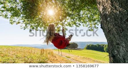 Nő dől fa nevet jókedv portré Stock fotó © IS2