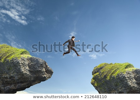 Man jumping across stream Stock photo © IS2