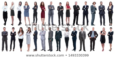 full length portrait of a confident young businesswoman in suit stock photo © deandrobot