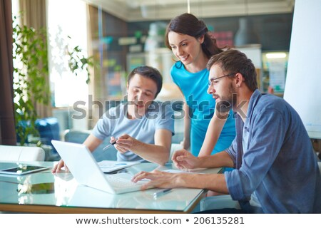 three businesspeople using laptop stock photo © is2