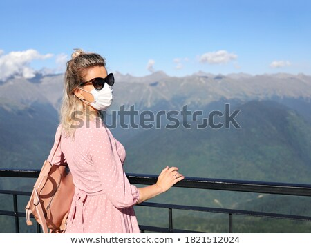 women with sunglasses looking at viewer stock photo © IS2
