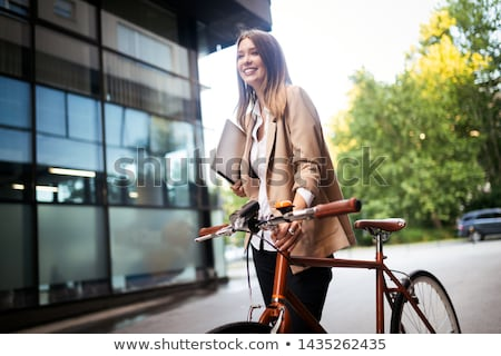 Woman and girl with bike Stock photo © IS2
