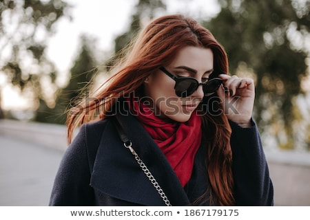 young casual woman walking with hair covering her face stock photo © feedough