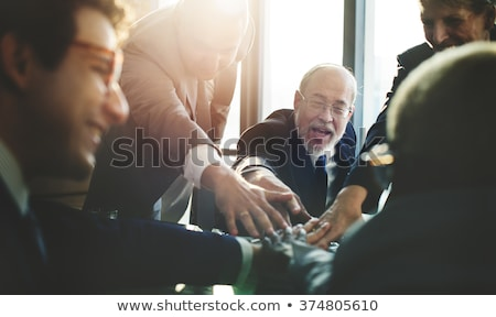 Business team closing a deal, happy Stock photo © IS2
