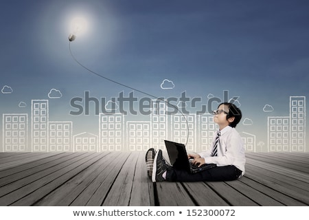 Boy with laptop, daydreaming Stock photo © IS2