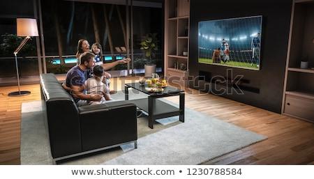 homem · tv · assistindo · sessão · sofá - foto stock © studioworkstock