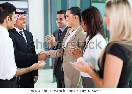 a middle eastern businessman and a caucasian businessman smiling stock photo © monkey_business
