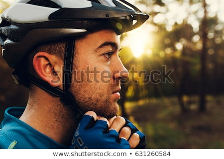 Close-up of male mountain biker wearing bicycle helmet Stock photo © wavebreak_media