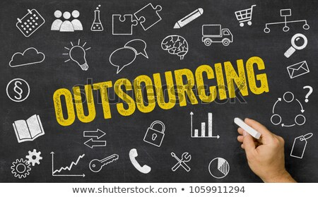 outsourcing written on a blackboard with icons stock photo © zerbor