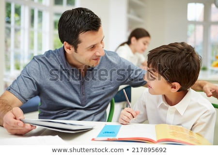 hispanic girl using digital tablet for school homework stock photo © diego_cervo