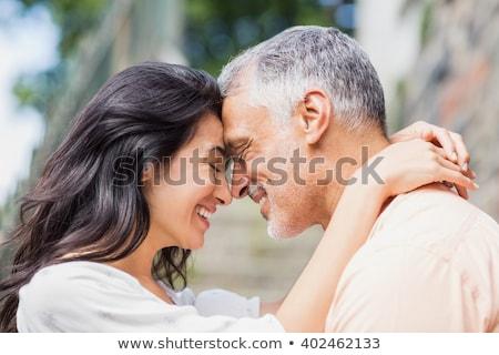Gyönyörű érett pár szeretet nő tengerpart Stock fotó © hannamonika