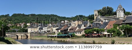 View at the medieval village of Montignac, at the foreground the Vezere river. stock photo © FreeProd