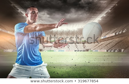 Composite image of sports player catching the ball Stock photo © wavebreak_media