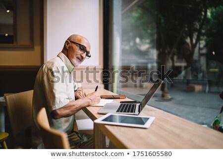 Zamyślony biznesmen patrząc w dół strona posiedzenia młodych Zdjęcia stock © feedough