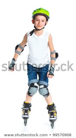 улыбаясь мало фигурист мальчика позируют колено Сток-фото © acidgrey