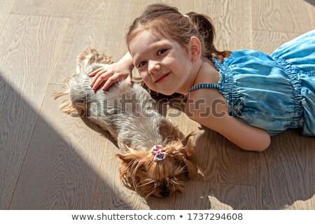 Girl and pet dog sleeping Stock photo © bluering