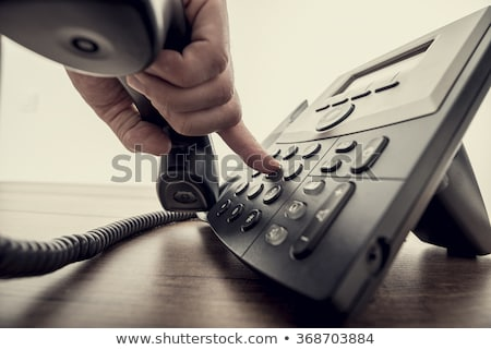 retro phone handset in male hand stock photo © studiostoks