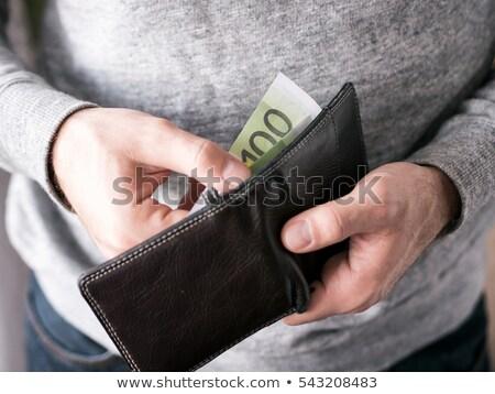Işadamı el dışarı euro cüzdan dolar Stok fotoğraf © ra2studio