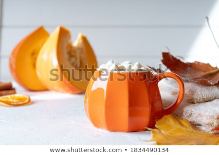 Top view composition with cup of coffee and marshmallow, pumpkin Stock photo © artsvitlyna