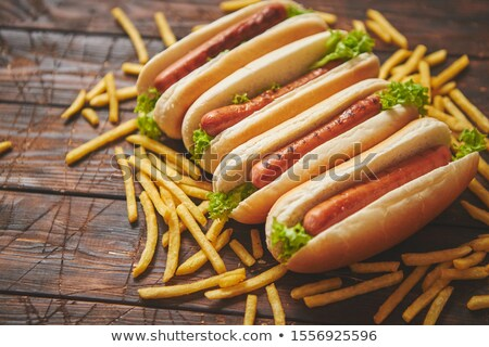 Tasty american hot dogs assorted in row. Placed on wooden table Stock photo © dash