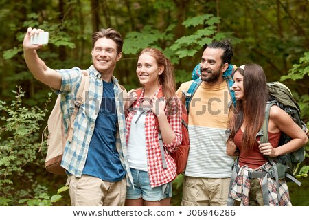 Stock photo: friends with backpacks taking selfie by smartphone