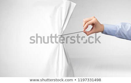 Hand pulling paper curtain Stock photo © ra2studio