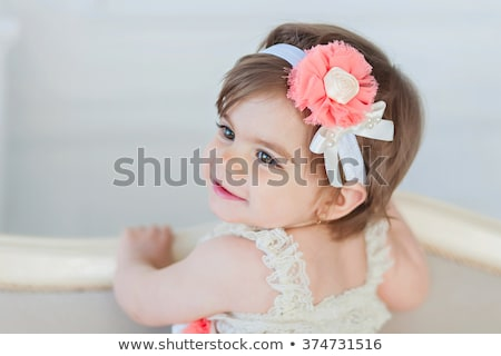 Stock photo: happy beautiful baby girl with flower headband