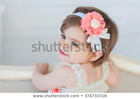 happy beautiful baby girl with flower headband stock photo © svetography