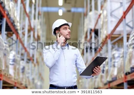 Zakenman roepen smartphone magazijn groothandel business Stockfoto © dolgachov