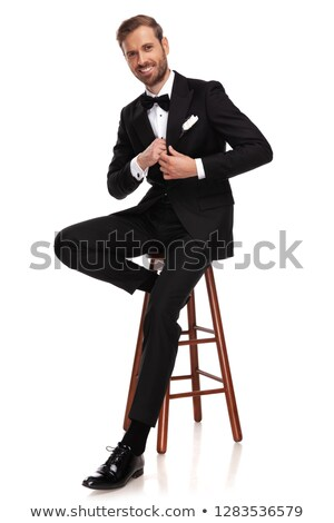attractive businessman picks something from inner pocket Stock photo © feedough