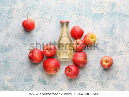 Glass Bottle of apple organic vinegar on blue background.  stock photo © Illia