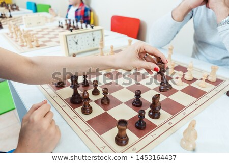 Woman making a chess move playing against a man Stock photo © Kzenon