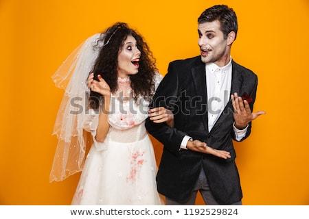 Photo of happy zombie couple bridegroom and bride wearing weddin Stock photo © deandrobot