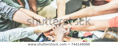 happy creative team stacking hands at office Stock photo © dolgachov