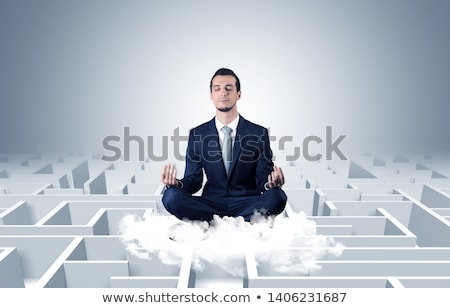 Businessman meditates on a cloud with maze concept Stock photo © ra2studio