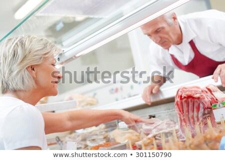 Vrouw slager winkel verkopen vlees filet Stockfoto © Kzenon