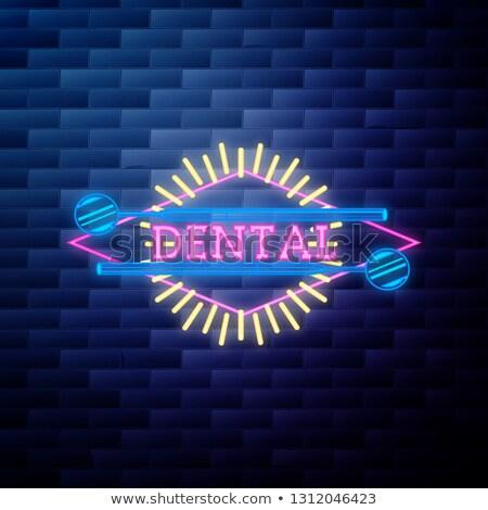 vintage dental emblem glowing neon sign on brick wall background Stock photo © netkov1