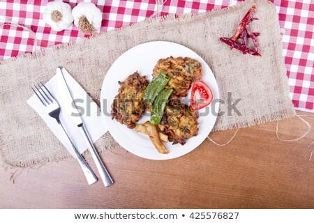 Homemade zucchini fritters with chorizo sausage and corn salsa stock photo © Melnyk