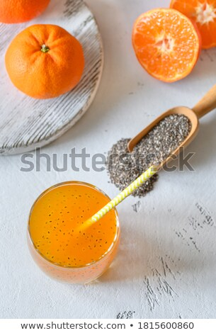 Chia seeds in wooden scoops, one of the superfoods Stock photo © Melnyk