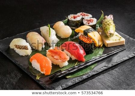 Sushi ayarlamak plaka ahşap balık restoran Stok fotoğraf © OleksandrO