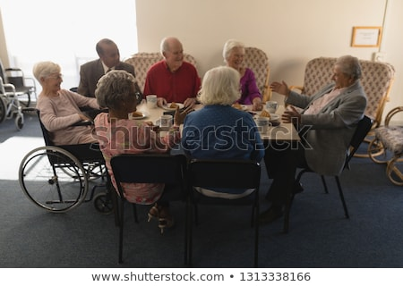 front view of happy group of senior friends having breakfast on dining table at home stock photo © wavebreak_media